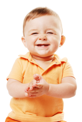 Baby in orange shirt with two teeth smiling
