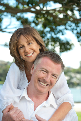 Mature white couple in white smiling