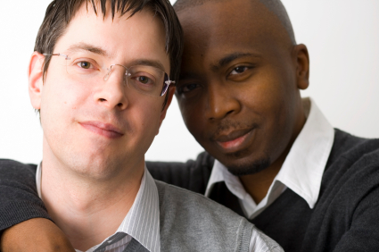 Two men interacial together arms around